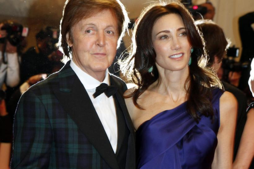 Nancy Shevell and Paul McCartney pose on arrival at the Metropolitan Museum of Art Costume Institute Benefit celebrating the opening of Alexander McQueen: Savage Beauty in New York