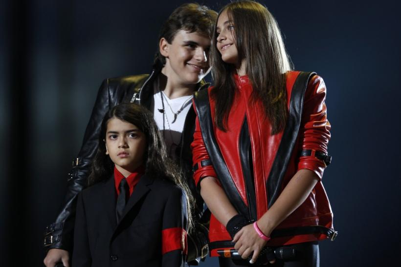 "Michael Jackson's children (L-R) Blanket, Prince and Paris stand on stage during the ""Michael Forever"" tribute concert, which honours late pop icon Michael Jackson, at the Millennium Stadium in Cardiff, Wales"