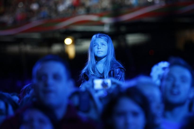 "A young girl watches the ""Michael Forever"" tribute concert, which honours late pop icon Michael Jackson, at the Millennium Stadium in Cardiff, Wales"