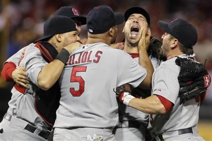 St. Louis Cardinals' starting pitcher Chris Carpenter (2nd R) celebrates winning Game 5 of their MLB National League Divisional Series baseball playoff game against the Philadelphia Phillies in Philadelphia
