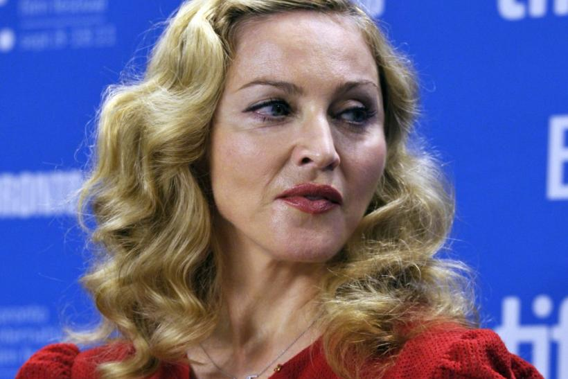 "Judging from what her manager tweeted Wednesday, Madonna's not amused that a source published a track called ""Give Me All Your Love"" while she was in the middle of recording it."