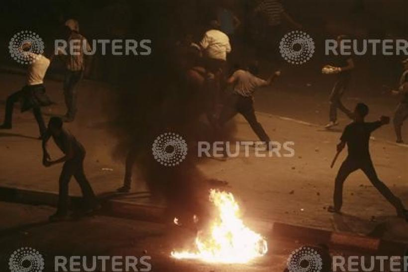 Egyptian Christians throw stones at soldiers and riot police during a protest against an attack on a church in southern Egypt, in Cairo