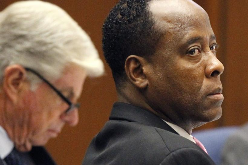 Dr. Conrad Murray sits at the defense table with his attorney J. Michael Flanagan during his trial in the death of pop star Michael Jackson in Los Angeles