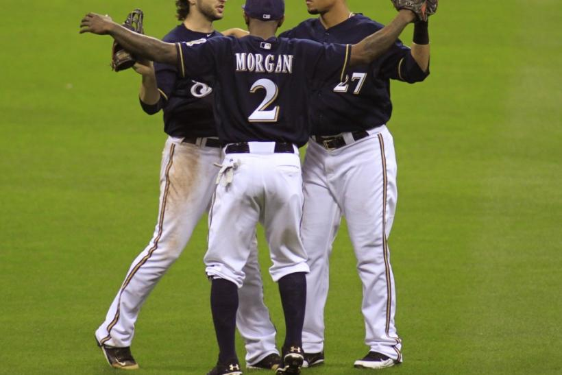 Milwaukee Brewers Ryan Braun, Nyjer Morgan and Carlos Gomez celebrate defeating the St. Louis Cardinals in Game 1 of the MLB National League Championship Series baseball playoffs in Milwaukee