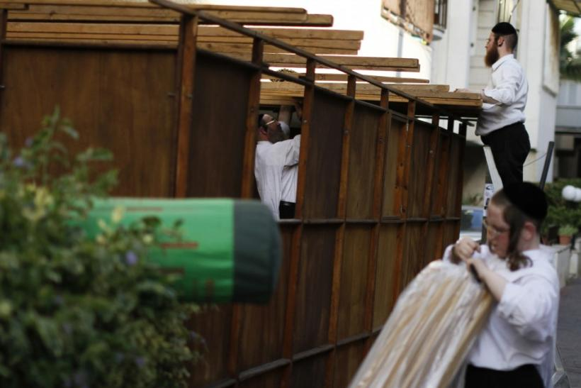 Ultra-Orthodox Jews build a ritual booth known as sukkah in Bnei Brak near Tel Aviv