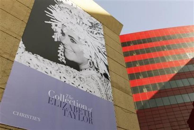 A large poster of the late actress Elizabeth Taylor is pictured at the press preview for Christie's auction of The Collection of Elizabeth Taylor featuring her jewelry, haute couture, fashion, and fine arts at MOCA Pacific Design Center in Los Angele
