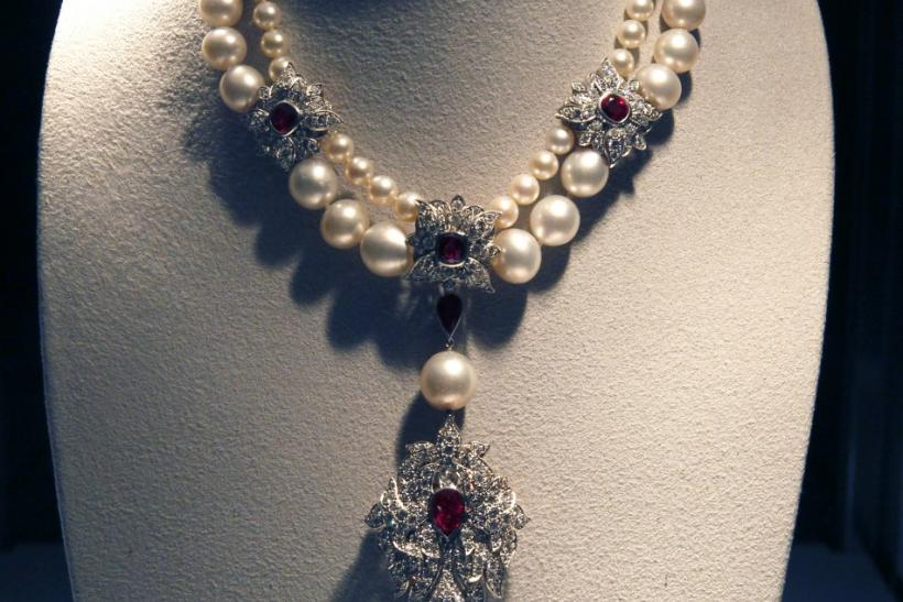 A ruby, diamond and pearl necklace by Cartier with the La Peregrina natural pearl pendant.