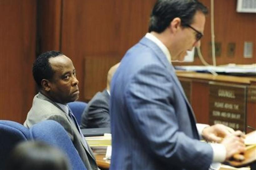 Dr. Conrad Murray listens as his attorney Ed Chernoff question a witness in his trial in the death of pop star Michael Jackson in Los Angeles