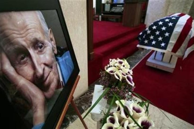 A portrait of assisted-suicide advocate Dr. Jack Kevorkian is seen next to his flag-draped casket following a public memorial at White Chapel cemetery in Troy, Michigan