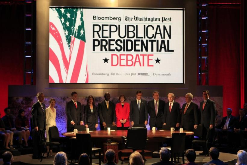 Republican presidential debate participants (L-R), former Utah Governor Jon Huntsman, U.S. Rep. Michele Bachmann (R-MN), Texas Gov. Rick Perry, Bloomberg reporter Julianna Goldman (not a candidate), businessman Herman Cain, debate questioner Karen Tumulty