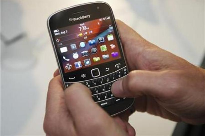 A person uses the new Blackberry Bold 9900 at a release party to promote the BlackBerry OS 7 devices made by RIM in Toronto