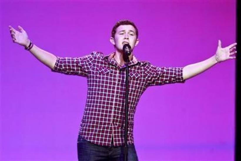 American Idol Season 10 winner Scotty McCreery performs during Wal-Mart Stores Inc's annual general meeting in Fayetteville, Arkansas