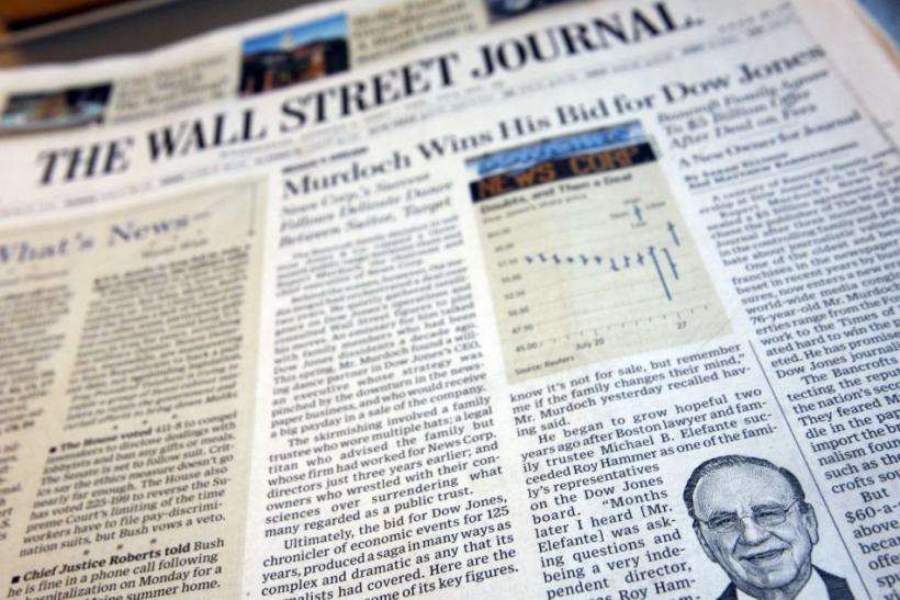 A photograph of the front page of the August 1, 2007 edition of the Wall Street Journal reports that Rupert Murdoch's News Corp will purchase Dow Jones & Co for some $5 billion.