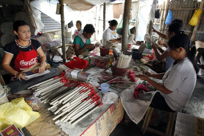 Workers wrap fireworks inside a makeshift factory in Bocaue town at Bulacan province. Phillipines.
