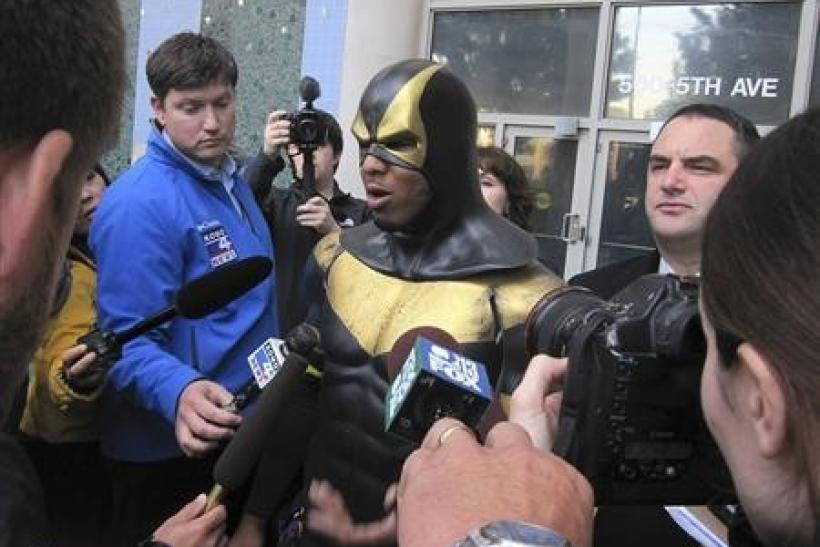 Benjamin Fodor, aka Seattle superhero ''Phoenix Jones'', speaks to the media after making a court appearance in Seattle, Washington