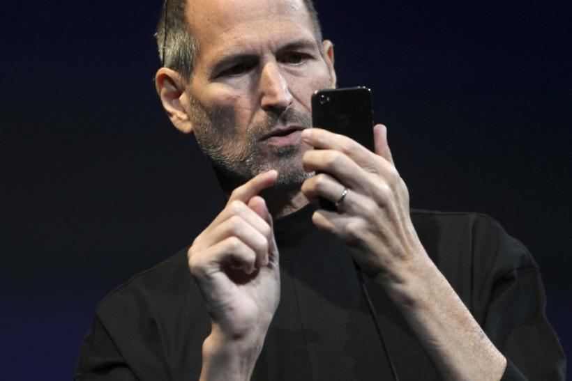 Apple CEO Steve Jobs demonstrates the new iPhone 4 during his appearance at the Apple Worldwide Developers Conference in San Francisco