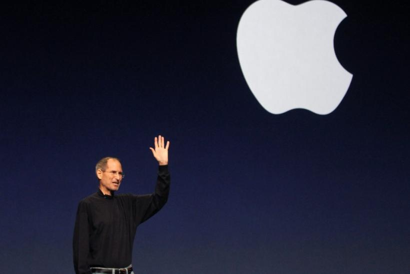 Apple Inc. CEO Steve Jobs gives a wave at the conclusion of the launch of the iPad 2 on stage during an Apple event in San Francisco