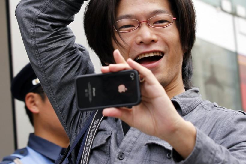 A man reacts as he enters an Apple store to buy iPhone 4S in Tokyo