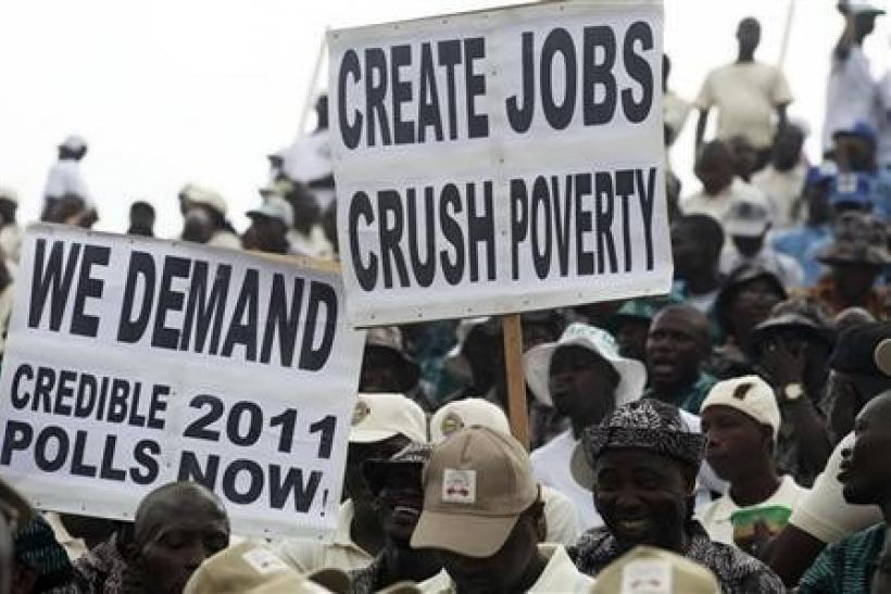 People display placards during a Labour Day parade in Nigeria