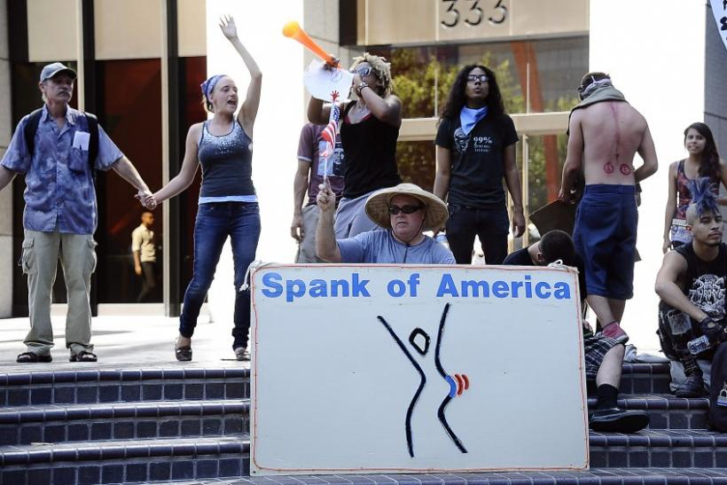 Occupy LA wall street protesters stage a rally in front of the Bank of America building in downtown Los Angeles, California