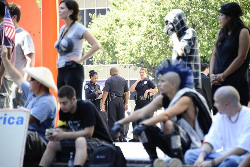 Los Angeles Police Department officers watch Occupy LA demonstrators at a rally in front of the Bank of America building in downtown Los Angeles, California