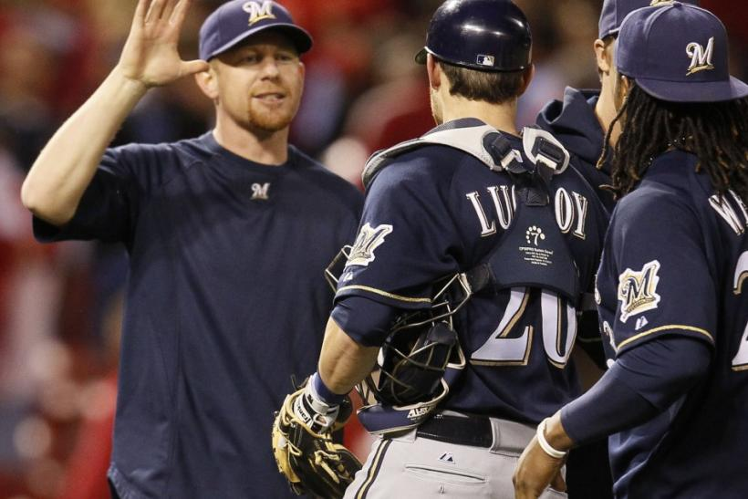 Milwaukee Brewers starting pitcher Randy Wolf celebrates with teammates after picking up his first post season win after defeating the St. Louis Cardinals in Game 4 of the MLB NLCS baseball playoffs in St. Louis