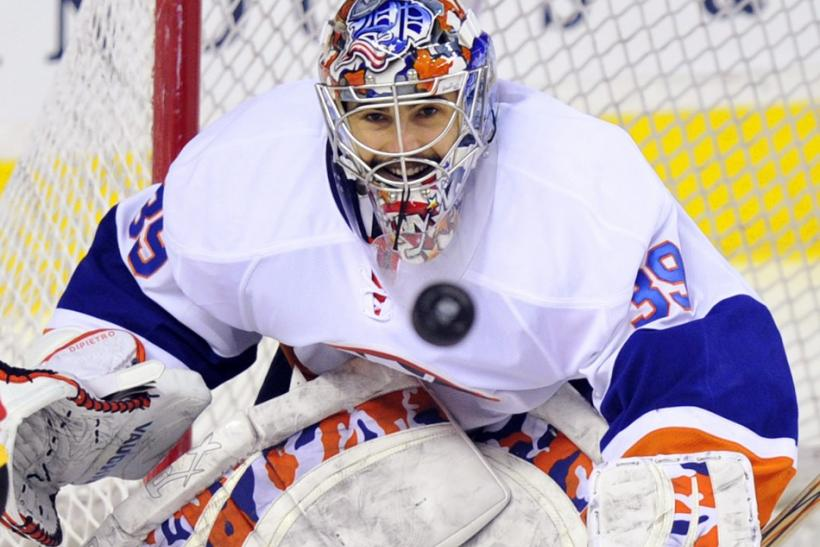 New York Islanders' DiPietro watches the puck before he gets hit with it during their NHL hockey game in Calgary.