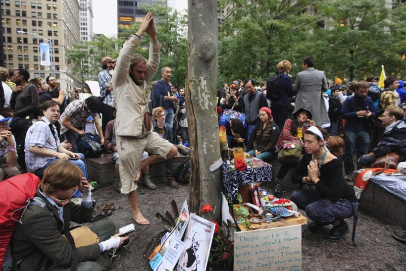 Members of the Occupy Wall Street movement perform yoga and prayer ceremonies in Zuccotti Park near the financial district of New York