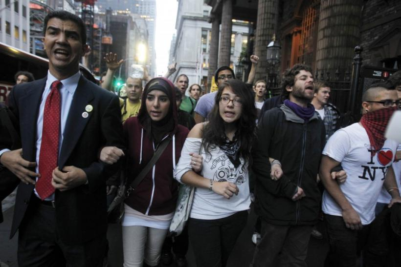 Occupy Wall Street protesters march in New York after learning that they will not be evicted from Zuccotti Park temporarily for cleaning
