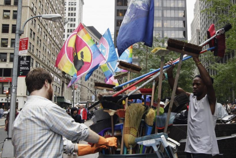 Members of the Occupy Wall Street movement replace brooms used for cleaning in Zuccotti Park near the financial district of New York
