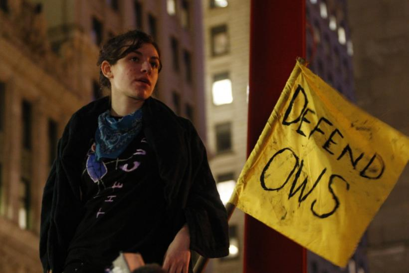 An Occupy Wall Street protester listens during a general assembly in New York's Zuccotti Park