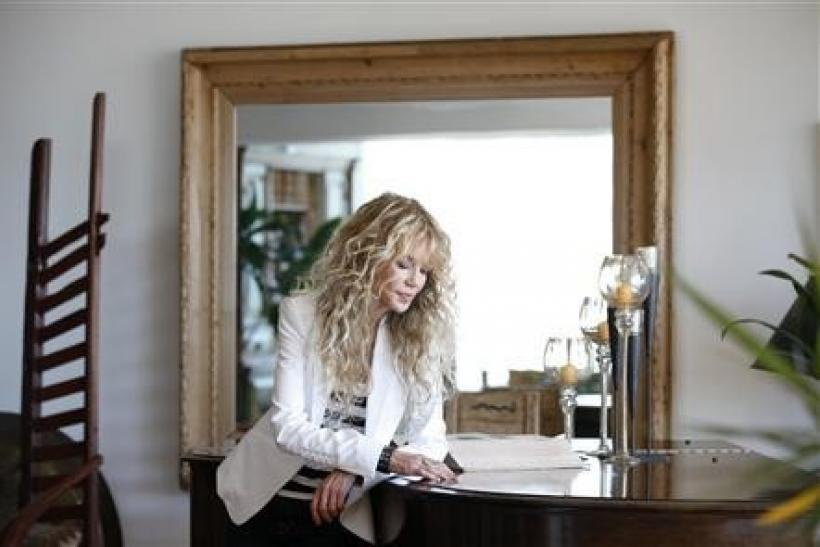 Actress Dyan Cannon poses for a portrait at her home in West Hollywood, California October 12, 2011. It was a fairy tale romance that turned in to a stormy marriage, and now Dyan Cannon has chronicled her relationship with Hollywood legend Cary Grant in h