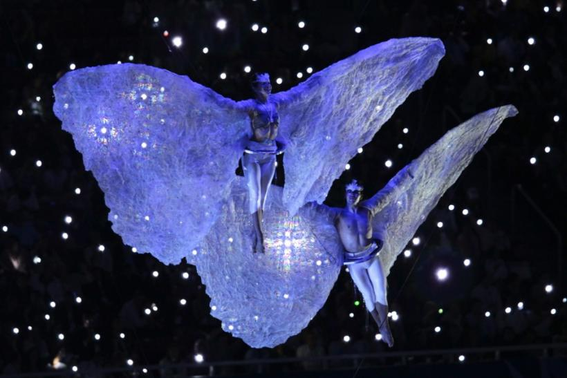 Performers wearing butterfly wings participate at the opening ceremony of the Pan American Games at Omnilife Stadium in Guadalajara
