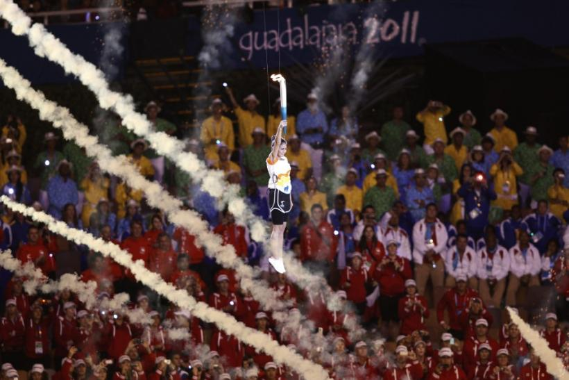 Paola Espinosa is lifted into the air after lighting the flame at the opening ceremony of the Pan American Games at the Omnilife Stadium in Guadalajara