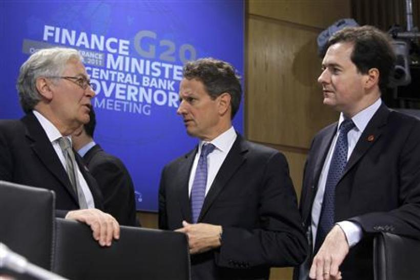 The Governor of the Bank of England Mervyn King talks to US Treasury Secretary Geithner and Britain's Chancellor of the Exchequer George Osborne in Paris