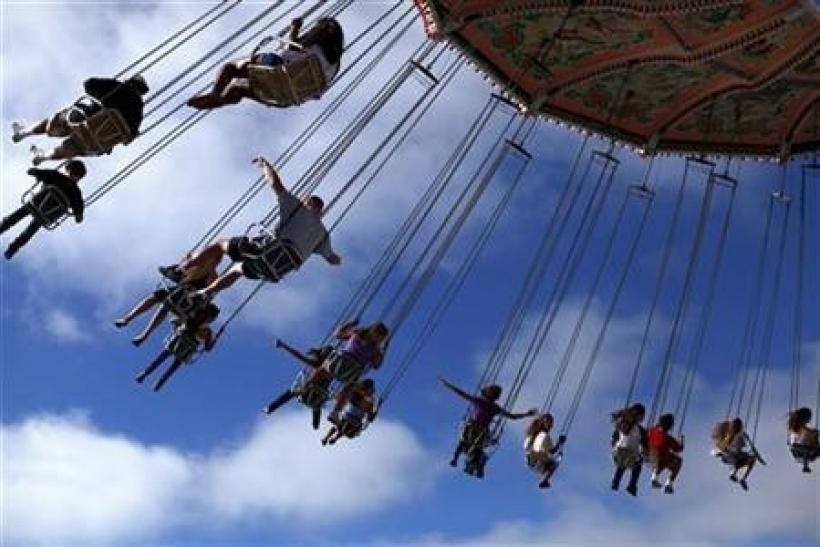 Fairgoers swing through the air on a ride at the San Diego county fair in Del Mar, California