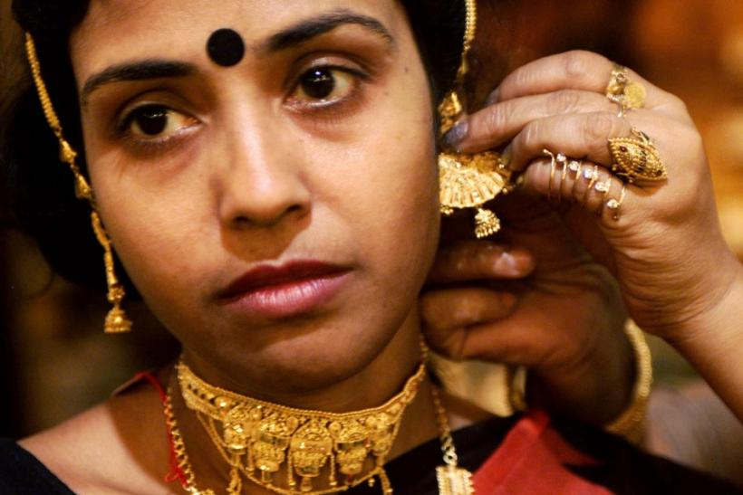 Indian woman tries on gold jewelry