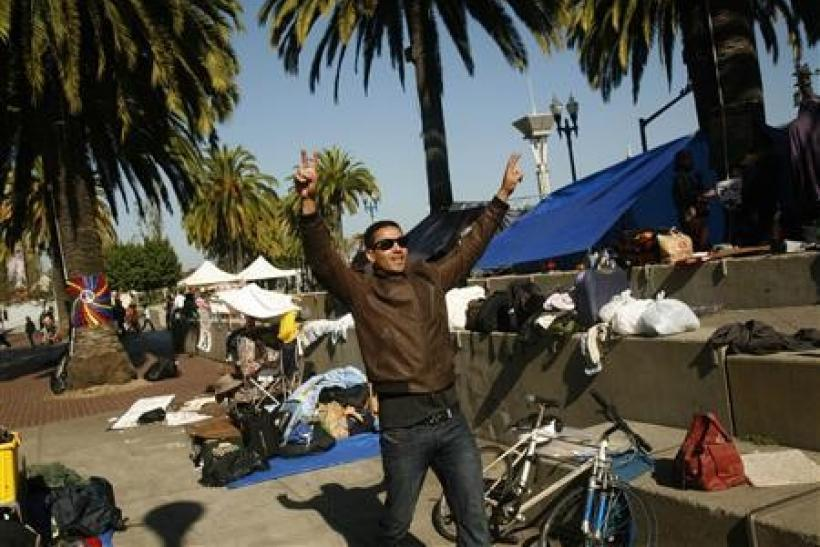 A man gestures at an encampment of Occupy San Francisco protesters at the Justin Herman Plaza in San Francisco, California
