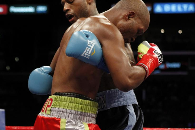 Bernard Hopkins (L) gets tangled up with Chad Dawson