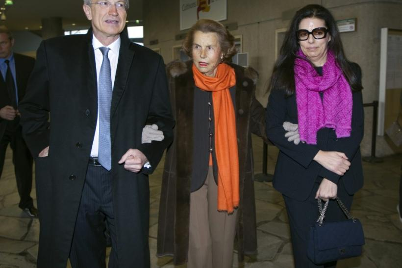 Cosmetics company L'Oreal chief executive Jean-Paul Agon, Liliane Bettencourt, heiress to the L'Oreal fortune and her daughter Francoise Bettencourt Meyers arrive for L'Oreal-UNESCO prize for women in Paris