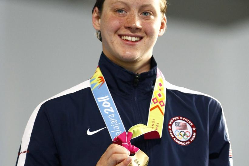 Gillian Ryan of the U.S. poses at the podium after winning the gold medal in the women's 400m freestyle final at the Pan American Games in Guadalajara