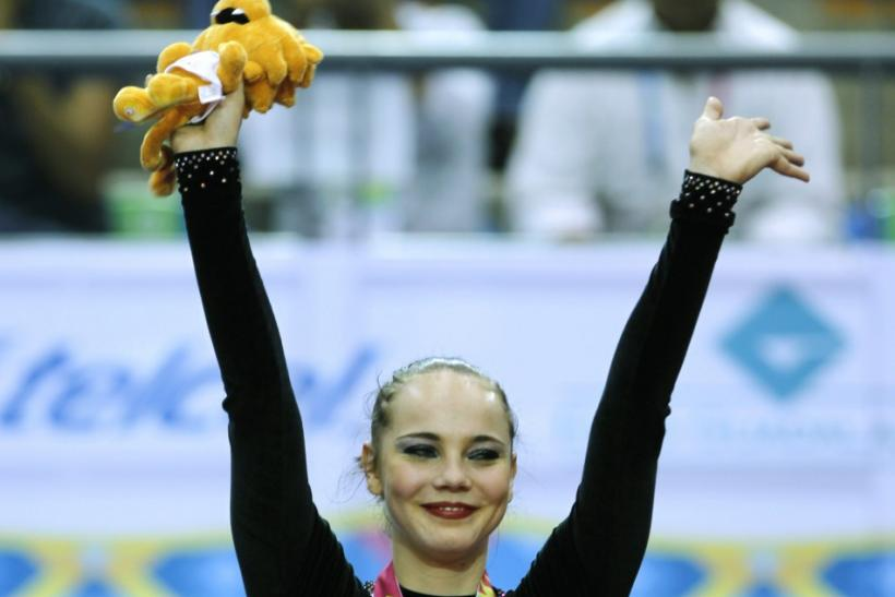 Angelica Kvieczynski of Brazil celebrates her bronze medal during the hoops final at the Pan American Games in Guadalajara