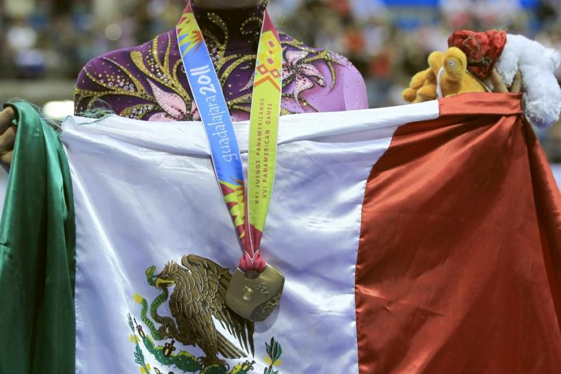 Cynthia Valdez of Mexico celebrates her gold medal during the hoops final at the Pan American Games in Guadalajara
