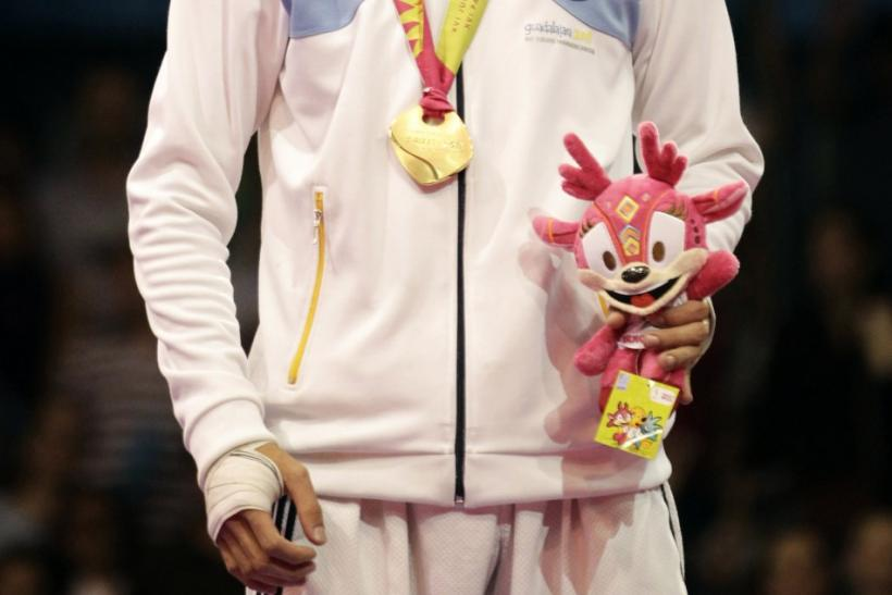Gold medallist Sebastian Crismanich of Argentina poses after winning the men's under 80kg final taekwondo competition at the Pan American Games in Guadalajara