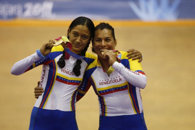 Venezuela's Daniela Larreal (L) and Mariestela Vilera celebrate with their gold medals after winning the women's team sprint cycling competition at the Pan American Games in Guadalajara