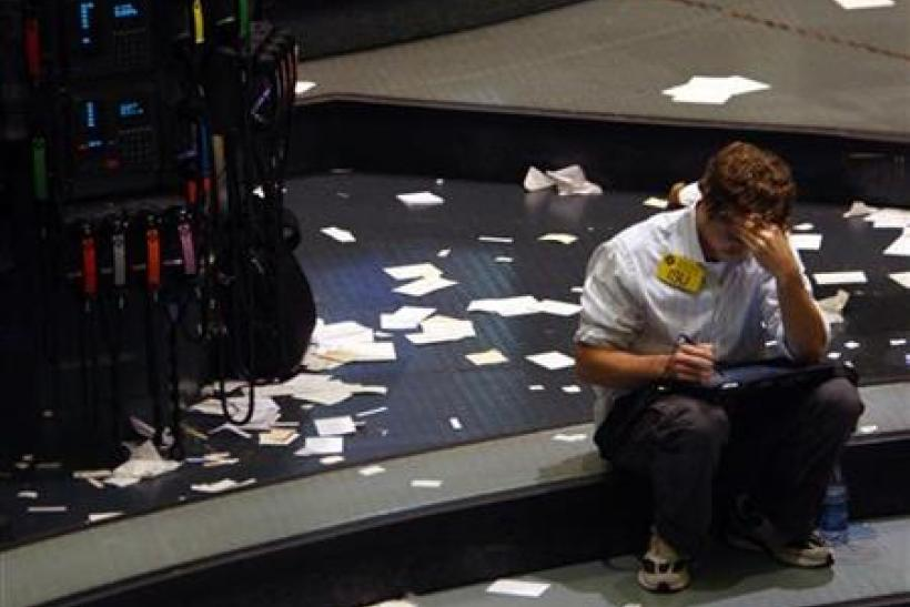 A trader works in the oil futures pit of the New York Mercantile Exchange in New York
