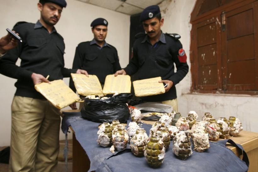 Police display explosives and drugs confiscated from six arrested Tehrik-e-Taliban Pakistan members during a news conference in Lahore