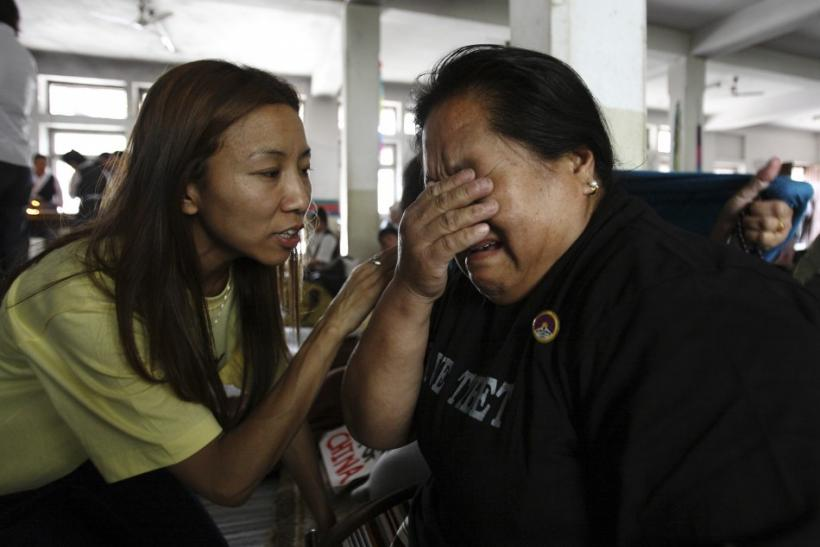 A Tibetan woman living in Nepal is comforted by a friend as she cries during a hunger strike in Kathmandu