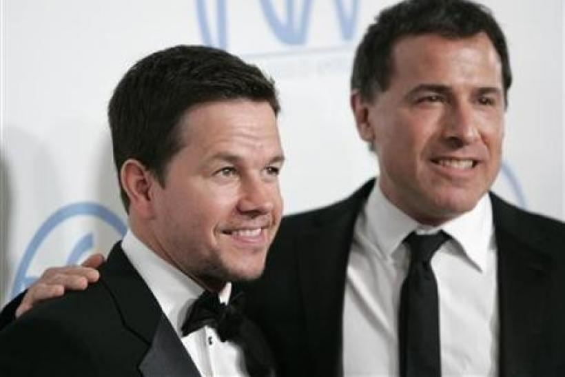 Actor Mark Wahlberg (L) and director David O. Russell arrive at the Producers Guild Awards at the Beverly Hilton Hotel in Beverly Hills, California