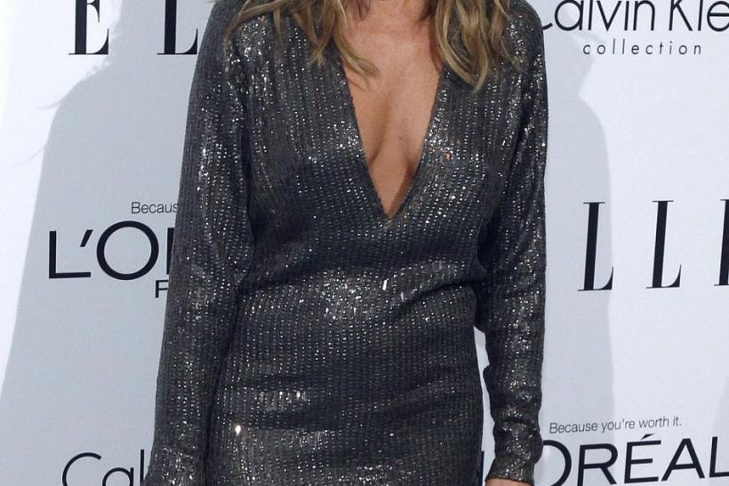 Actress Jennifer Aniston poses at Elle's 18th Annual Women in Hollywood Tribute in Los Angeles